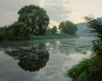Sunrise and mist on beautiful river