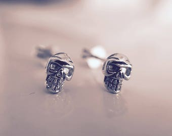 Teeny tiny 925 silver skull earrings.Solid shape.