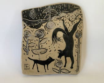 dogs playing in rain hand-carved ceramic art tile