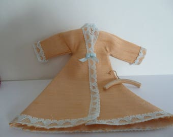 A Victorian Style Peach Wild Silk Tea Gown ,with lace trim.(with coat hanger) one 12th scale