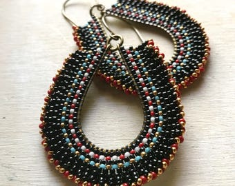 Black beaded hoop earrings with red, white, blue and gold accents