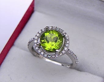 AAAA Peridot  8.00mm 2.16 Carats Untreated  Round in 14K white gold Halo ring with .25 carats of diamonds.  1561