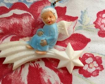 Vintage miniature Celluloid Angel on Star Ornament