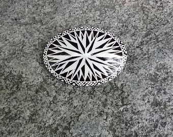 Black and white star goose eggshell pysanky pin
