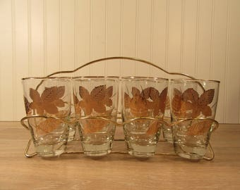 Eight clear glass and gold leaf design vintage Libby drinking glasses with fold up carrier