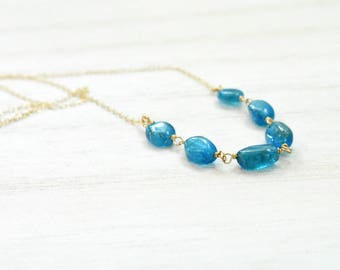 special purchase. neon blue apatite necklace. gold filled chain. natural apatite ovals necklace. linked apatite necklace. blue necklace