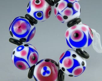 handmade lampwork glass bead set of 7 rounds in blue fuchsia black and white vibrant patterns - Roaring 20s