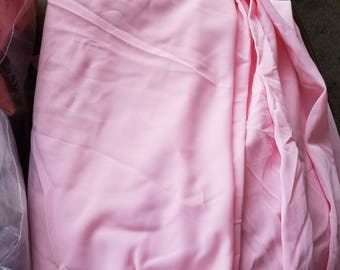 Medium Pink Nylon Tricot sold by the 1/2yd camera changed color