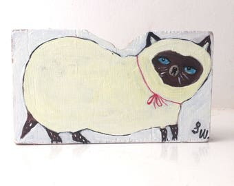 Little painting on reclaimed wood of a seal point kitten
