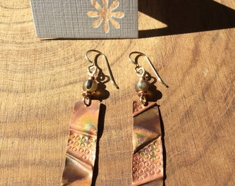 Foldformed Copper earrings with asymmetrical texture.