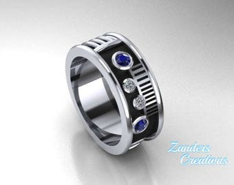 Saber Ring with a genuine blue sapphire and diamonds set in 14k white gold