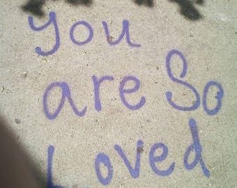 love photo, self-love art, love photography, graffiti quote, sidewalk writing, tagging, cement, purple and gray, shadows, wall art, teens