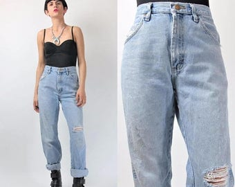 30% Off FLASH SALE 80s 90s Wrangler Jeans Distressed Ripped Knee Jeans Vintage Thrashed Faded Holes Medium Wash Denim Worn In Womens Grunge