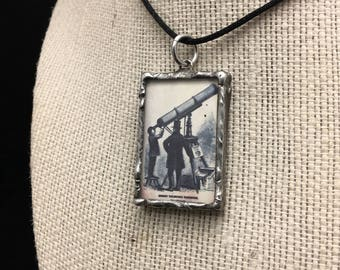 """Soldered Glass Pendant with a quote by Oscar Wilde: """"We are all in the gutter but some of us are looking at the stars."""""""