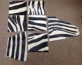 6-839.  Package of 7 Zebra Print Hair on Cowhide Remnants