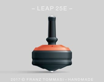 LEAP 25E Orange-on-Black Spin Top with orange cover over black body, ergonomic stem with rubber grip, dual ceramic tip, and 3 accent holes