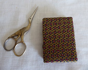 Gold red and blue silk needle book