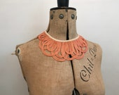 Vintage 1920s to 1930s peachy orange tape collar