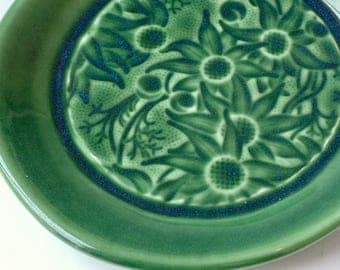 Deep green ceramic plate with Australian Flannel Flowers
