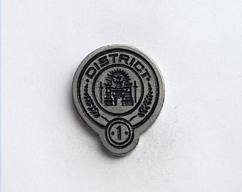 Hand Cast District One (Hunger Games) 1 in. Lapel Pin