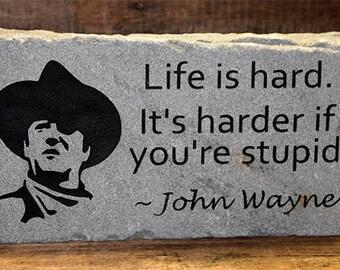 Custom engraved rock, Life is hard. It's harder if you're stupid. -John Wayne