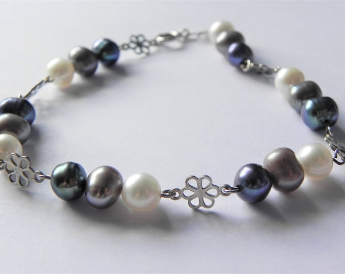 Freshwater pearl in peacock, silver and white with sterling silver flowers bracelet.