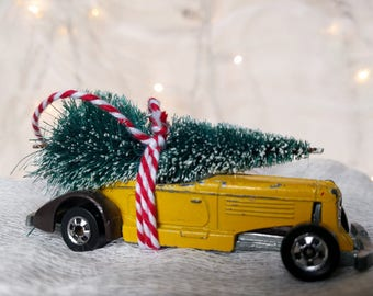 Yellow Hot Rod Classic Car with Tree Strapped to the Top Ornament by Distinguished Flamingo