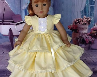 18 inch Retro ruffled dress. Fits American Girl Dolls. Yellow dress with lace trim.