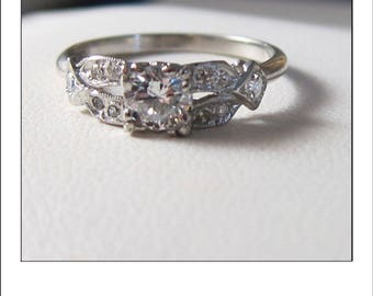 Antique Deco Platinum .71 ct Diamond Engagement Ring with gorgeous rosette shoulders