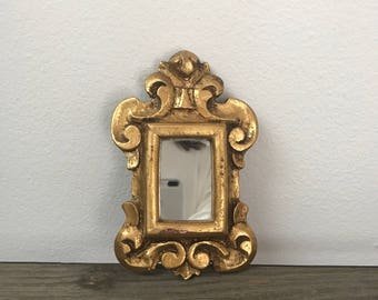 Small vintage gold rectangle shape with scrolls mirror
