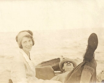 "Vintage Snapshot ""A Day On The Water"" Attractive Woman In Rowboat Reclining Man Hat Over Eyes Found Vernacular Photo"