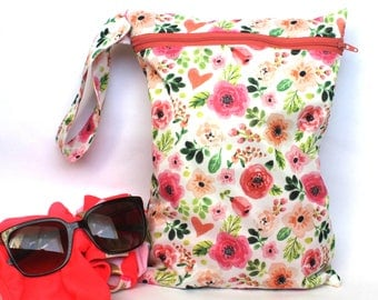 "Wet bag in water colour floral print! 9""x12"" perfect travel size! fits approximatley 4 cloth diapers"