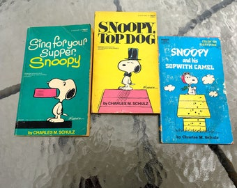 """Vintage 70's - 80's """"SNOOPY PAPERBACKS"""" by Charles Schulz - Lot of 3."""