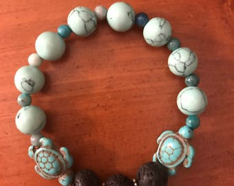 Lava rock bracelet with turtle stone and turquoise beads.