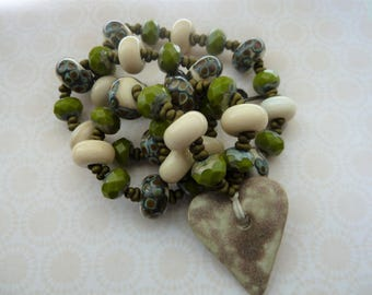 handmade lampwork and ceramic copper heart necklace, cream and green UK jewellery
