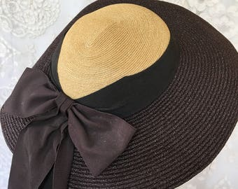 Vintage Fedora Style HAT. Dark Brown Wide Brim With Black Wide Grosgrain Ribbon Around Carmel Colored Crown. Long Ribbon Down Back.
