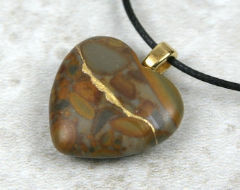 Broken heart pendant in mixed brown stone with gold kintsugi (kintsukuroi) style repair on cotton cord - OOAK