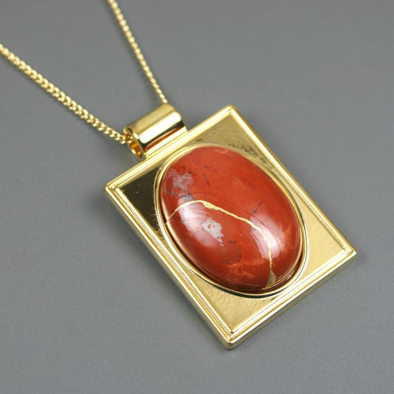 Kintsugi (kintsukuroi) red jasper stone cabochon with gold repair in a rectangular gold plated setting on gold chain - OOAK