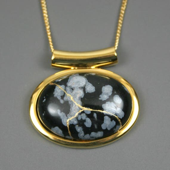 Kintsugi (kintsukuroi) snowflake obsidian stone cabochon with gold repair in a gold plated setting on gold chain - OOAK