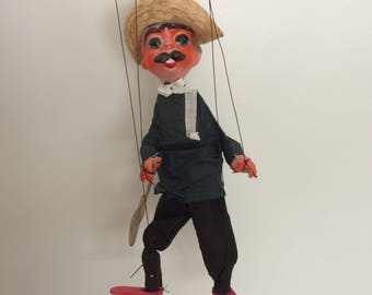 Vintage Mexican marionette puppet man with mustache and guitar souvenir