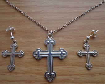 Silver cross on chain, and matching earrings.