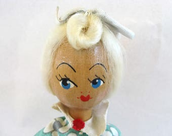 vintage wooden doll with sweet face and big feet