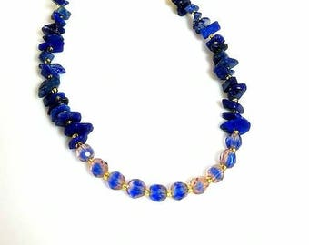 cobalt blue lapis lazuli gemstone chip necklace with blue beads peach markings dark blue stone necklace beaded gold chain jewelry