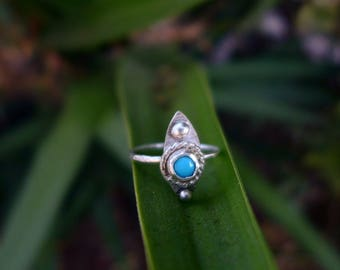 Leaf Shaped Turquoise Stone Ring, .925 in a size 8.