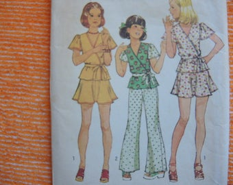 vintage 1970s simplicity sewing pattern 6305  girls size 12 front wrap top short skirt and wide leg pants