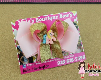 pink bow with gold