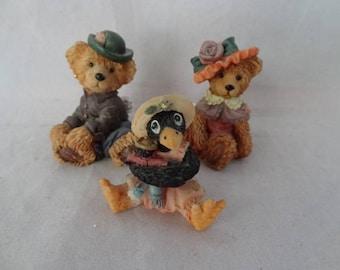 Adorable Teddy Bears with Hats & Black Crow Figurines