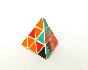 Logic game. Triangle Rubik's Cube. Logic puzzle. Vintage pyramid puzzle. 3D logic game. Vintage Logic Game. Triangle pyramid. Logic toy.