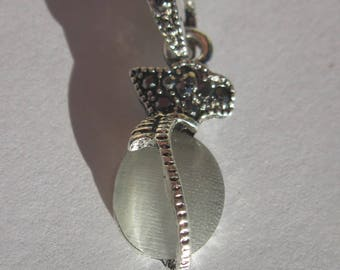 glass rimmed metal and Rhinestone Charm Pendant (2002)