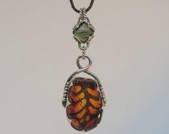 amber and moldavite silver pendant